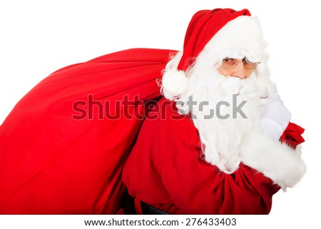 Photo of Santa Claus with sack full of presents.