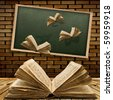 Photo of urban interior with school blackboard and opened vintage flying book - stock photo