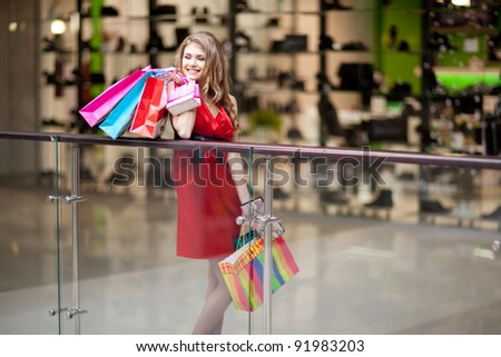 ... with shopping bags on the background of shop windows - stock photo