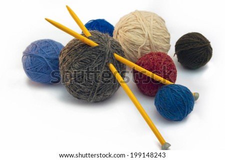 Photo skeins of yarn and spokes for knitting.