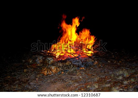Photograph of a blazing bonfire at night (Australia).