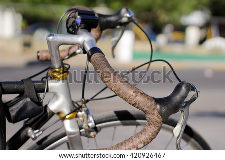 Photograph of a pair of bicycle handlebars and blurred background
