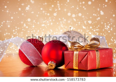 Photograph of some shiny red christmas ornaments