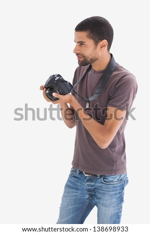 Photographer at work on white background