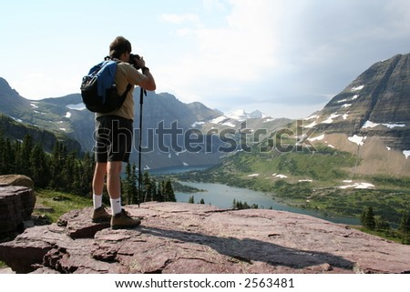 Photographer on Cliff at Glacier National Park