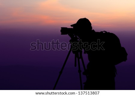 Photographer take a shot at Top of Mountain