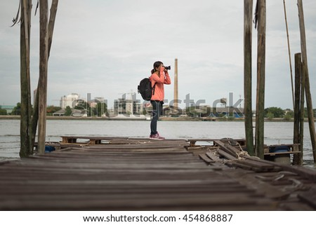 photographer taking a photo with river view
