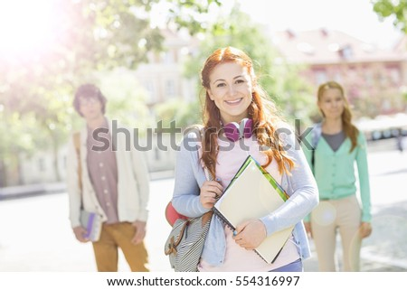 Photography of students studying outdoors and enjoying themselves very much