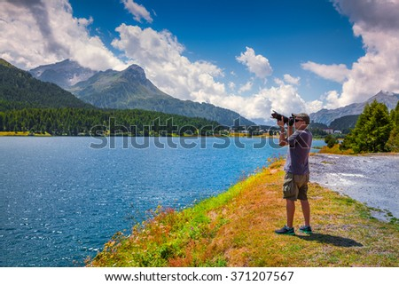 Photograpther take picture on the Silsersee lake. District of Maloja, Swiss canton of Graubunden, Switzerland, Alps, Europe.