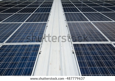 Photovoltaic or Solar Panels Against The Deep Blue Sky And Clouds.