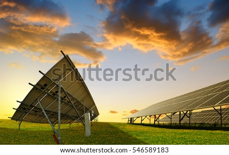 Photovoltaic panels at sunset. Power plant using renewable solar energy.