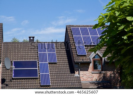 Photovoltaics on the roof of a residential building