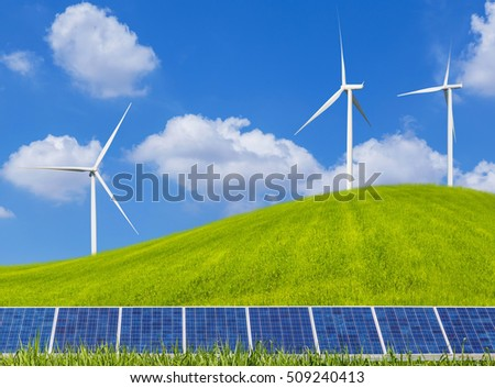 photovoltaics solar panels and wind turbines generating electricity on grass hill and blue sky with clouds.Ecology green nature concept.