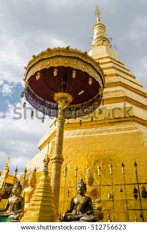 PHRAE, THAILAND - NOVEMBER 1, 2016 : Golden Pagoda in Wat Phra That Cho Hae Temple on November 1, 2016. Wat Phra That Cho Hae Temple in the most important temple in Phrae province, Thailand.