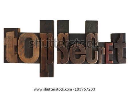phrase top secret in vintage wooden letterpress type, scratched and stained, isolated on white background
