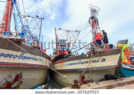 PHUKET - JULY 27 : Fishing boats stand in the harbor To transport fish from the boat to the market which 100% of labor on boat is Burmese on July 27, 2014 in Phuket, Thailand.