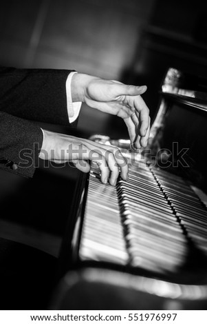 Pianist hands playing black and white