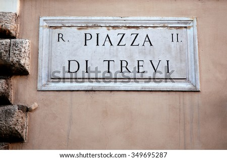 Piazza di Trevi sign on building wall in Rome, Italy