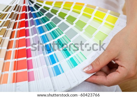 Woman Hand Pointing Sample Color Chart Stock Photo