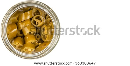 Pickled chili in white bowl over white background