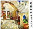 pictorial courtyards of Santorini - artistic picture - stock photo