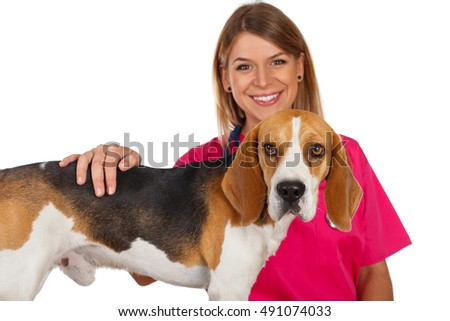 Picture of a beautiful young veterinarian with a cute beagle