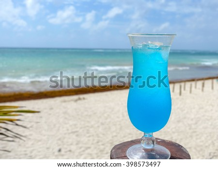 Picture of a blue cocktail drink,taken on a beach at the Maya Riviera in Mexico.