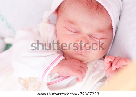 picture of a newborn baby sleeping in baby crib