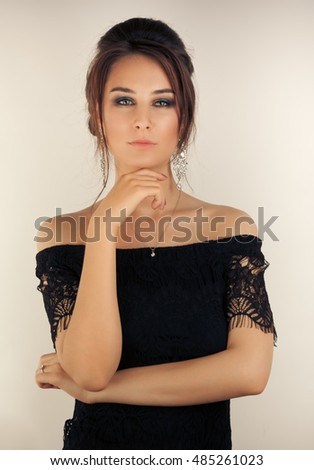 Picture of beautiful woman with make-up and hairstyle looking to the camera