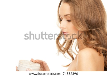picture of beautiful woman with moisturizing creme