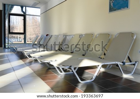 picture of empty lounge sofas row in spa resort