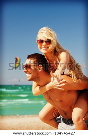 picture of happy couple in sunglasses on the beach  (focus on woman)