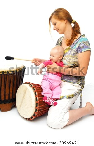 picture of happy mother with baby with drum over white