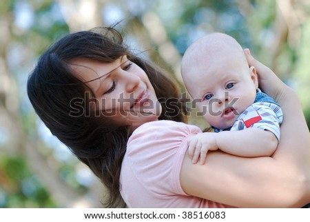 picture of happy mother with thoughtful baby