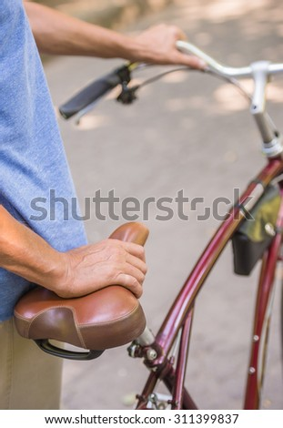 Picture of man with bicycle in the park, close-up.
