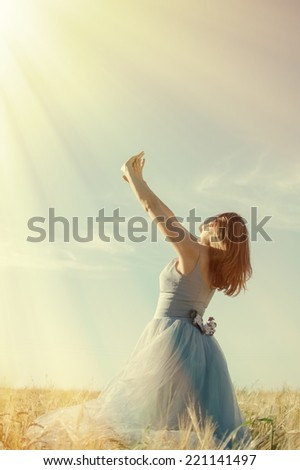 Picture of one young pretty lady having fun standing in the field hands up on blue sky copy space background