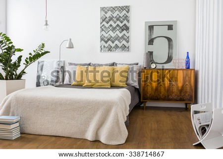 Picture of stylish cozy bedroom with new furniture
