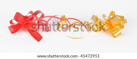 Picture of varicoloured bows for the decoration of gifts on a white background