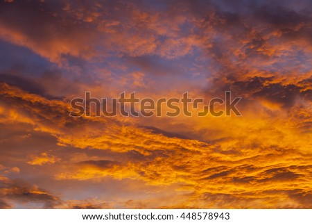 Picturesque heavenly landscape. The clouds lit with the sun at sunset