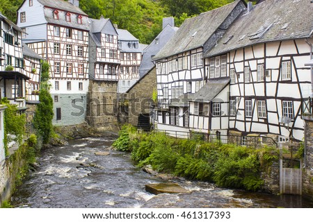 picturesque houses along the Rur River in the historic center of Monschau, Germany