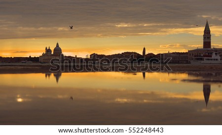 Picturesque St. Mark square and Santa Maria della Salute church view at sunset, Venice, Italy