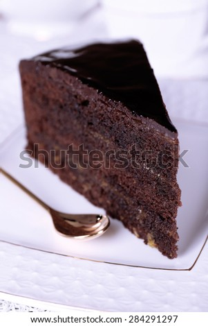 Piece of chocolate cake on white plate, closeup