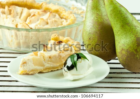 Piece of cottage cheese cake with pear and vanilla ice cream.