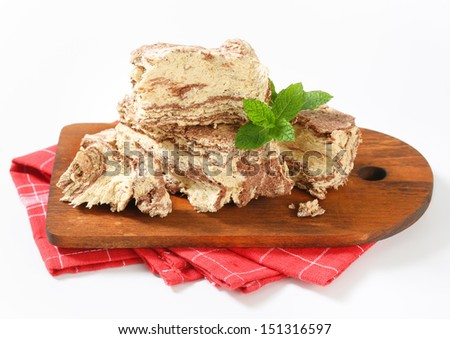 Pieces of chocolate halva on a cutting board