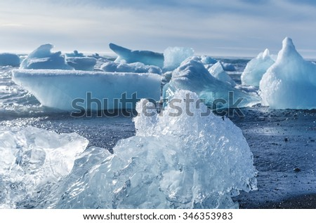 pieces of iceberg afloat in the ocean