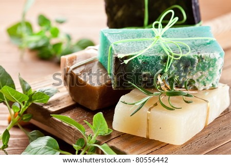 Pieces of natural soap with herbs.