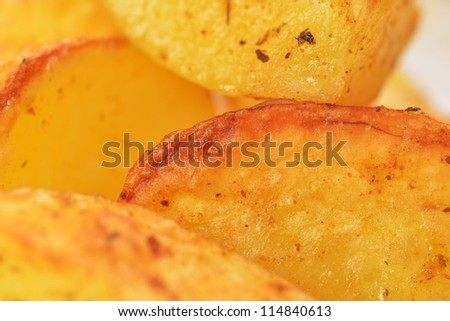 Pieces of tasty roast potato close up
