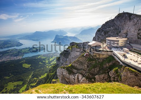 PILATUS - LUZERN, SWITZERLAND - AUGUST 6 2015 - Pilatus  - world's steepest cogwheel railway and view to Swiss Alps from the top of Pilatus mountain