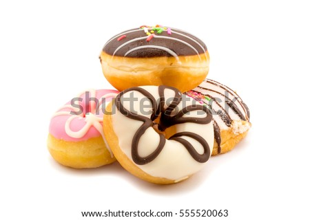 Pile of assorted homemade tasty donuts on white background