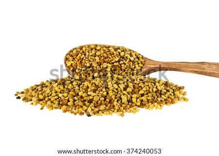 Pile of bee pollen in wooden spoon on a white background
